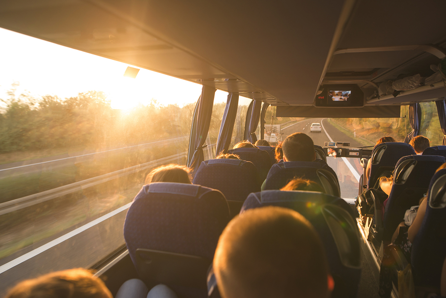 people commuting to work on a bus