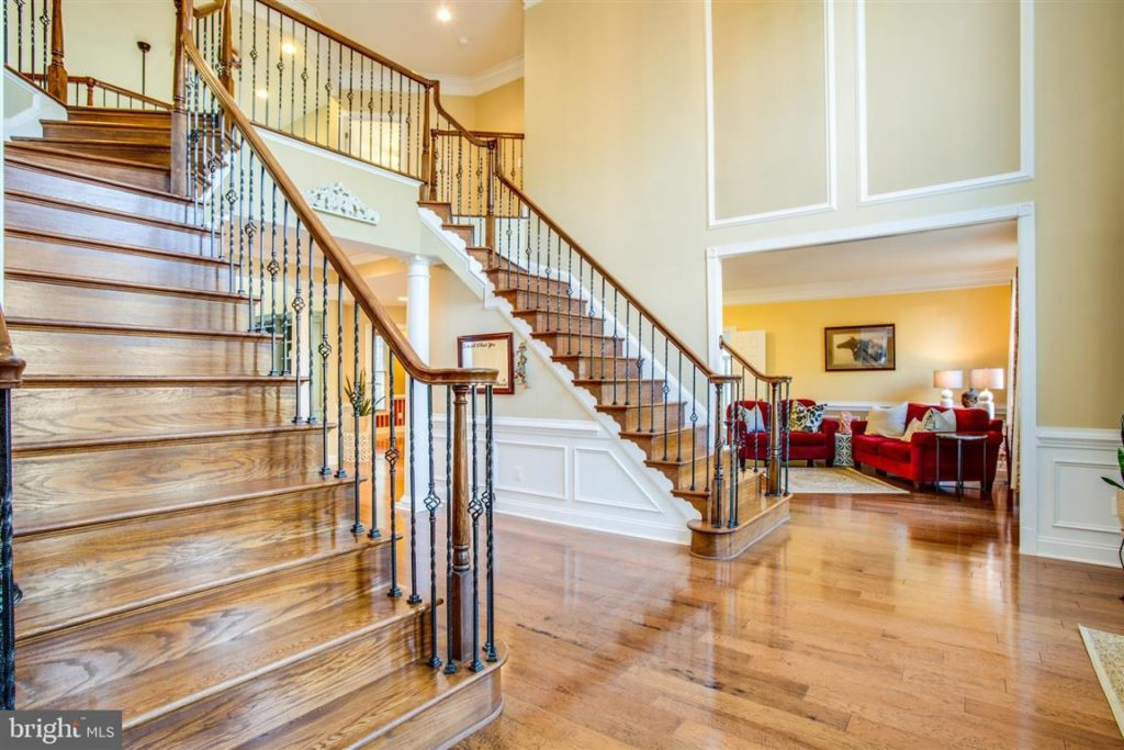 grand double staircase twin foyer